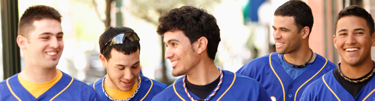 Students wearing baseball uniforms